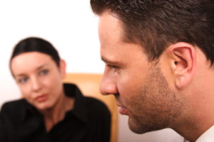 Man and women talking in a counselling session